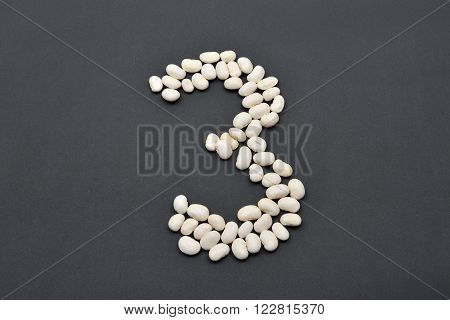 Number Three Made From White Beans On Black Background. Food Vegan, Vegetarian. Healthy Food