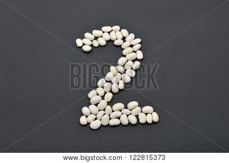 Number Two Made From White Beans On Black Background. Food Vegan, Vegetarian. Healthy Food