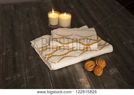 Folded Towel And Napkin With Orange Concave Line Design