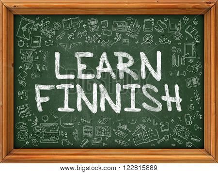 Learn Finnish - Handwritten Inscription by Chalk on Green Chalkboard with Doodle Icons Around. Modern Style with Doodle Design Icons. Learn Finnish on Background of Green Chalkboard with Wood Border.