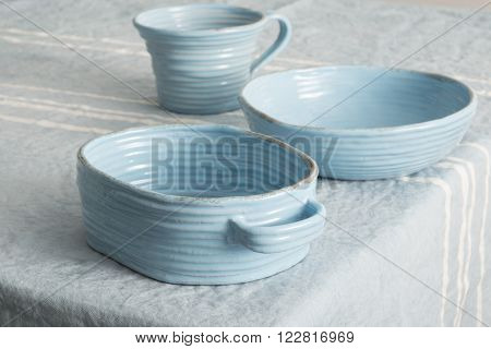 Set Of Blue Earthenware On Blue Linen