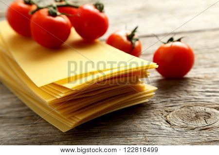 Lasagne Sheets Pasta With Cherry Tomato On A Grey Wooden Table