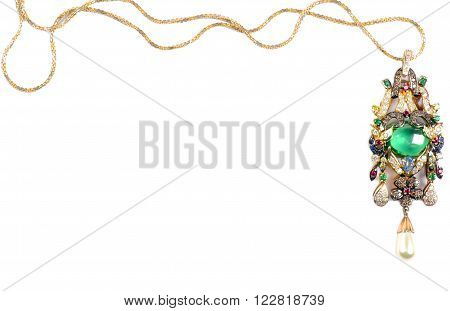 Golden  necklace with emerald and gems, over white