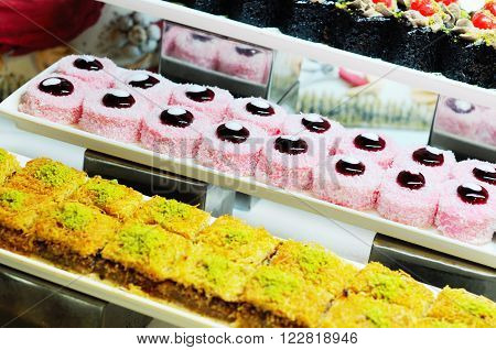 Cakes assortment  with chocolate and fruits, close up