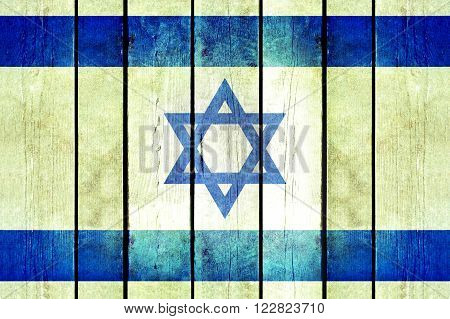 Israel wooden grunge flag. Israel flag painted on the old wooden planks. Vintage retro picture from my collection of flags.