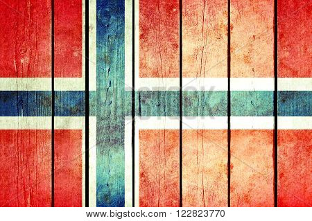 Norway wooden grunge flag. Norway flag painted on the old wooden planks. Vintage retro picture from my collection of flags.