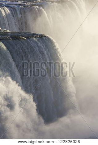 water falling down on Niagara Falls on the border Ontario river between the USA and Canada Ontario in winter time