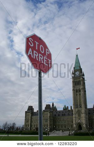 bilingual stop sign and Canadian Parliament Ottawa Canada