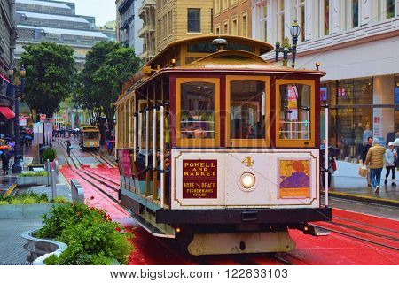 March 13, 2016 in San Francisco, CA:  Historic Cable Car on California Street in Downtown San Francisco, CA which is a moving historical landmark transporting passengers during the rain