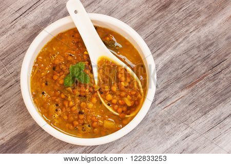 Dal Indian lentil curry soup for flat bread and rice
