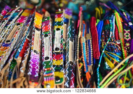 ANTIGUA GUATEMALA, GUATEMALA, 29 JANUARY 2016: Numerous wristbands with Guatemala sing at the craft market
