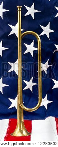 A brass bugle on a American flag.