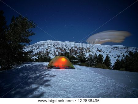 lighting tent, cloud formation and moonlight on winter Volcano Etna landscape, Sicily
