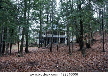 A house in the woods along Glenn Drive in Harbor Springs, Michigan during December.