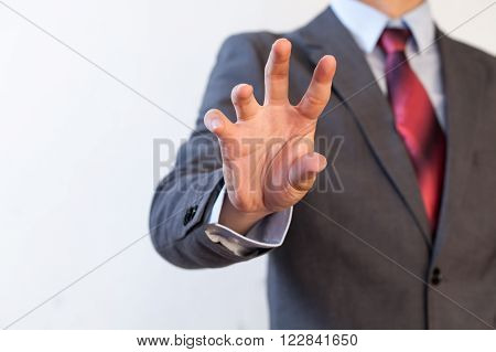 Businessman pinching in the air with five fingers - Digital and imagination concept