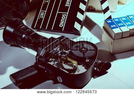 Movie Camera with the lid open. Reel with film and cinema clap. Cinema film boxes.