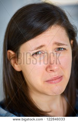 Sad female face, close to crying
