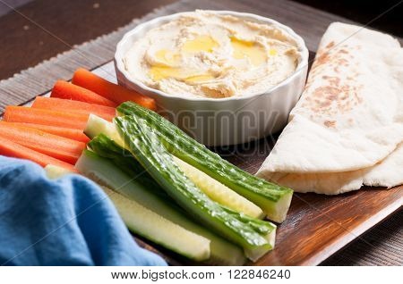 vegetable sticks with hummous or hummus and hand made flatbread