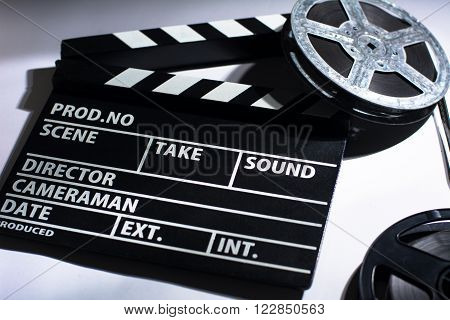 Clap cinema, metal or plastic reel of film. Objects for shooting movies and demonstrations