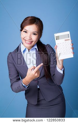Businesswoman finger point to calculator