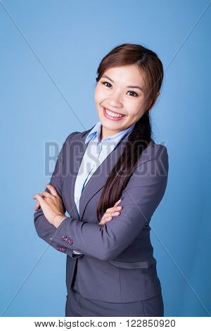 Young businesswoman over blue background