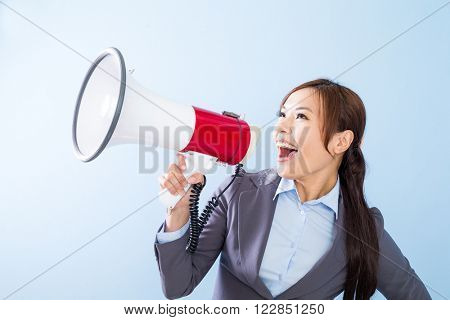 Businesswoman yell with loudspeaker