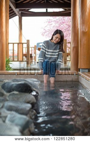 Woman feeling relax with her legs in onsen