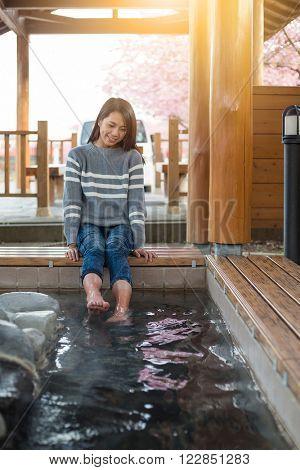 Woman enjoy onsen on feet