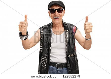 Studio shot of a senior punk rocker giving two thumbs up isolated on white background