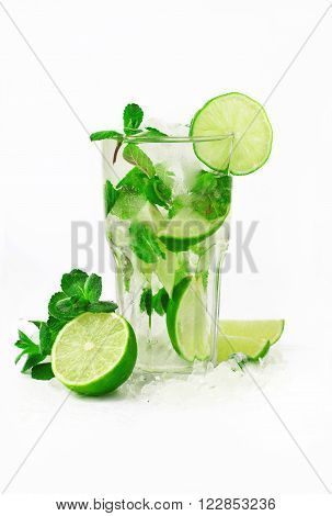 Mojito cocktail with lime and mint in tumbler glass on white background