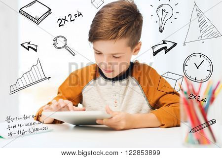 leisure, children, technology and people concept - close up of boy with tablet pc computer at home over mathematical doodles
