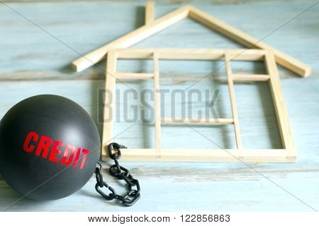 Slave housing loan concept with credit iron ball and house symbol