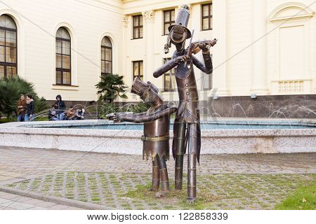 SOCHI RUSSIA - November 5 2015: Sculpture of stray dogs musicians play a musical instrument and beg it is set in a park of Arts in Sochi Russia
