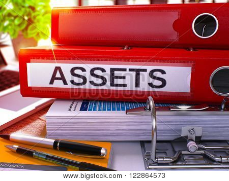 Red Office Folder with Inscription Assets on Office Desktop with Office Supplies and Modern Laptop. Assets Business Concept on Blurred Background. Assets - Toned Image. 3D Render.