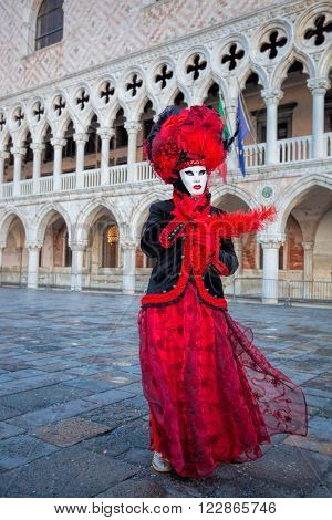 Carnival Mask Against Doge Palace In Venice, Italy