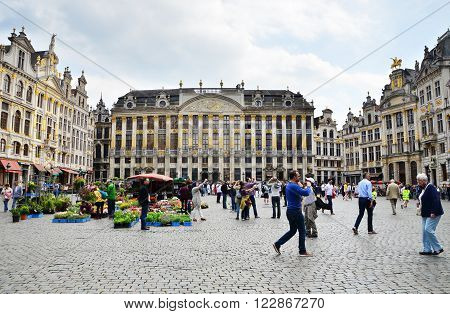 Brussels Belgium - May 13 2015: Many tourists visiting famous Grand Place the central square of Brussels. The square is the most important tourist destination and most memorable landmark in Brussels.