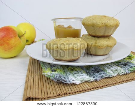 Homemade pancake muffins with apple sauce in glass