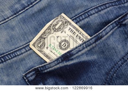 one dollar sticking out of a pocket of jeans