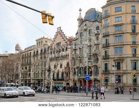Barcelona, Spain - March 01, 2016: Street scene with tourist gathering in front of Gaudi building Casa Battlo on Passeig de Gracia in Eixample district.