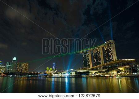 SINGAPORE CITY, SINGAPORE - FEBRUARY 20, 2016: Marina Bay Sands at night during Light and Water Show 'Wonder Full' . It opened on 27 April 2010. Singapore on FEBRUARY 20, 2016
