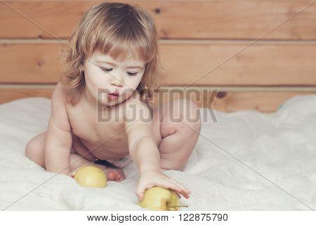 Boy Eating Apples