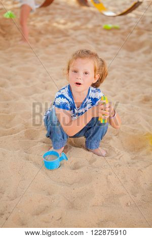 The Girl Playing To A Sandbox