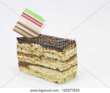 Chocolate cake slice spongy creamy on white background
