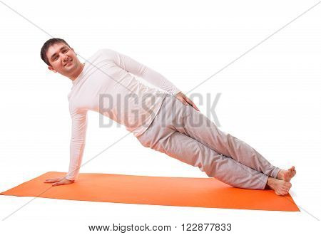 Young slim handsome man practicing yoga isolated on white background