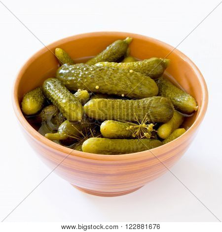 Pickled Cucumbers Gherkins In Ceramic Cup On A White Background