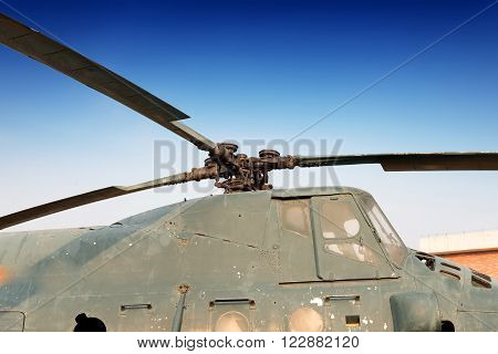 Old, scrapped helicopter fuselage and propeller close-up