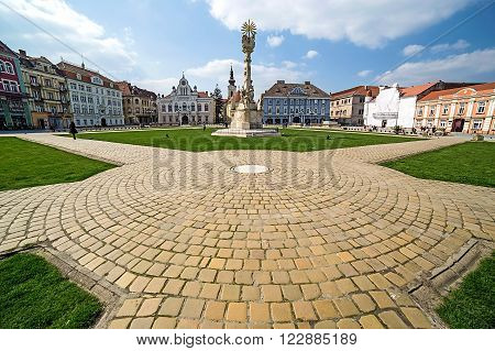 TIMISOARA ROMANIA - MARCH 18 2016: Panoramic view of one part at Union Square in Timisoara Romania with old buildings. Trinity Statue and serbian vicariate in foreground.