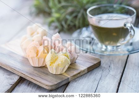 Cotton - wool cake on wooden thai dessert thai steamed cupcakes muffin cup cake or cotton-wool cake