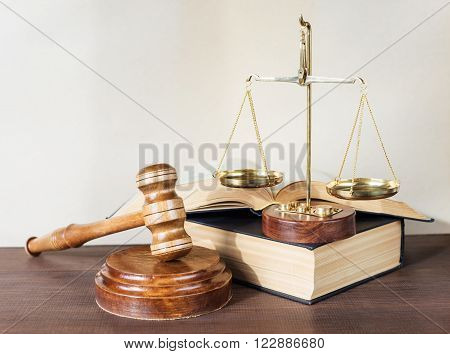 Symbols of law: wood gavel soundblock scales and opened volumetric old books