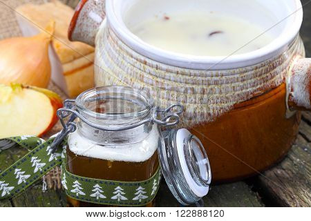 lard in ceramic pot and preserving jar